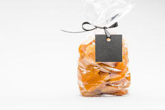 Bag of candied apricots isolated on white and blank label Royalty Free Stock Photo