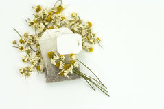 Bag of chamomile tea with dry chamomile Stock Images