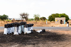 Bag of charcoal along the road in africa Royalty Free Stock Photo