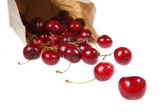 Bag of Cherries. Cherries spilling out of a brown paper bag Stock Photos