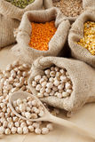 Bag with chickpeas and sack with grains Royalty Free Stock Photo