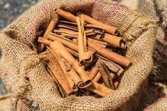 Bag of Cinnamon sticks background at market Stock Photography