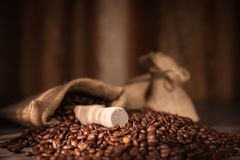A bag of coffee. With coffee bean as background Stock Photos