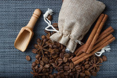 Bag of coffee beans with anise on sackcloth.  Royalty Free Stock Photography