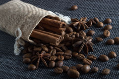Bag of coffee beans with cinnamon and anise. Bag of coffee beans with cinnamon Royalty Free Stock Image