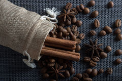 Bag of coffee beans with cinnamon and anise. Bag of coffee beans with cinnamon Royalty Free Stock Photo