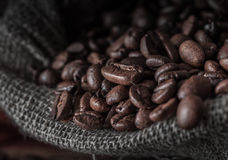 Bag of coffee beans on a dark background. Stock Images
