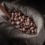 Bag of coffee beans on a dark background. Royalty Free Stock Photos