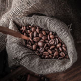 Bag of coffee beans on a dark background. Stock Photography