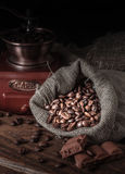 Bag of coffee beans on a dark background. Stock Photos