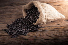 Bag of coffee beans scattered Stock Photo