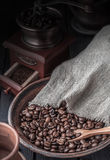 Bag of coffee beans and Vintage coffee grinder on a dark wooden Royalty Free Stock Images