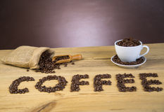 Bag of coffee beans on wooden table Stock Image