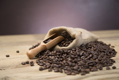 Bag of coffee beans on wooden table Royalty Free Stock Photos