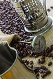 Bag of coffee beens and thermometer Royalty Free Stock Photo