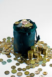 Bag of coins. And scattered small, copper coins Stock Image