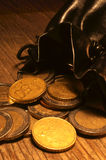 Bag of coins. On a beautiful textured table Royalty Free Stock Image