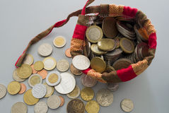 Bag of coins from different countries Stock Photo