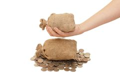 Bag with coins in a female hand Stock Photography
