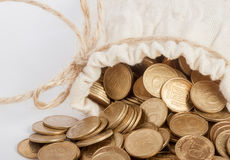 Bag with coins. Bag with many ukrainian coins on white background Royalty Free Stock Photography