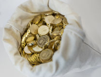 Bag of coins on a white background Stock Photography