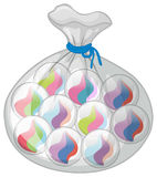 Bag of colorful marbles Royalty Free Stock Photos