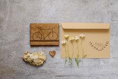 Bag content accessories collection in beige color theme with bag, paper tag, chamomile Stock Photo