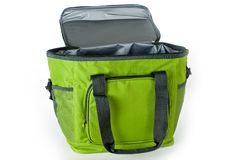 Bag cooler bright green for carrying and storing products stock photos