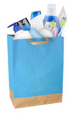 Bag with cosmetics. Bag with detergents and cosmetics isolated on white background Stock Image