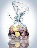 Bag of custom candies. Bag of custom expensive hard colored candy Stock Images