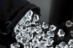 Bag of diamonds. Falling on a table royalty free stock photos