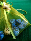 Bag with dice. Fancy green bag containing dice Stock Photography