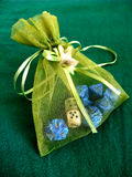 Bag with dice. Fancy green bag containing dice Stock Photo
