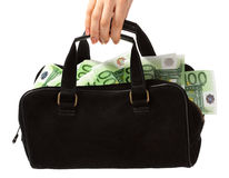 Bag and euro. Bag is in womanish hand and euro Royalty Free Stock Image