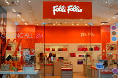 Bag fashion shop Folli Follie. Famous brand shop window with purses on display boutique in AFI Palace Cotroceni,Bucharest,Romania.Famous brand shop window with Stock Photo