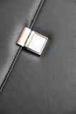 Bag fastener. Metal fastener on a leather bag stock images