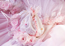Bag of fiancee. With pink roses royalty free stock photos