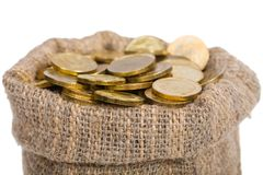 Bag filled with coins. Royalty Free Stock Photography