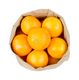 Bag filled with small oranges Royalty Free Stock Images