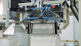 Bag filling machine in the factory. Bag filling machine. Device for filling bags in the factory, close-up stock footage