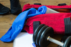 Bag on the floor with sports things. Things for sport lie in bags for men Royalty Free Stock Images