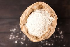 Bag of flour. On wooden background royalty free stock photos
