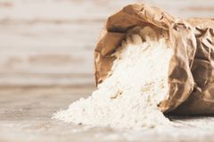 Bag of flour. On wooden background royalty free stock image
