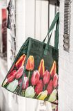 Bag with flower print. Hanging on a doorway Stock Image