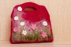 Handmade Felted Bag. With floral decoration stock image