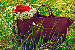 Bag with flowers. Woman bag with flowers outdoor Stock Photography