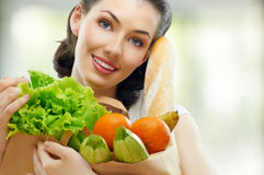 Bag of food. Girl holding a bag of food royalty free stock photography