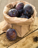 Bag of Fresh Purple Plums Stock Photo