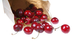 Bag of Fruit. Ripe cherries spilling out of a brown paper bag Stock Photos