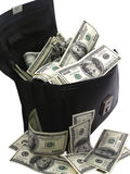 A bag full of cash dollars Royalty Free Stock Image